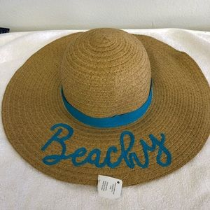 Beautiful floppy straw hats with tags attached.